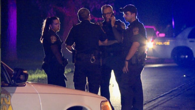 Police discuss a hit-and-run investigation in the 3200 block of W. Kessler Blvd. N. Drive on Monday.