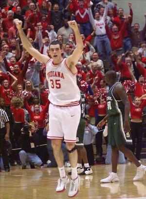 Indiana's Kirk Haston (35) celebrates after he hit a 3-point shot against Michigan State's Zach Randolph, with time running out to upset the top ranked Spartans, 59-58 in Bloomington, Ind.,  Jan. 7, 2001.