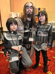 During the Star Trek: Next Generation convention, dad, Michael Roney, Jr. and his children, Scotland, (left) and Ireland, pose for photographers in their Kilingon costumes.  This year,s Annual Starbase Indy Star Trek convention is at the Marriott East (7202 E. 21st Street). The convention continues all day Sunday, November 25, 2012.