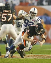 Colts defensive tackle Anthony McFarland closes in on a sack on Bears quarterback Rex Grossman in the third quarter. Indianapolis Colts versus the Chicago Bears in Super Bowl XLI on February 4, 2007 at Dolphins Stadium in Miami, Fla.