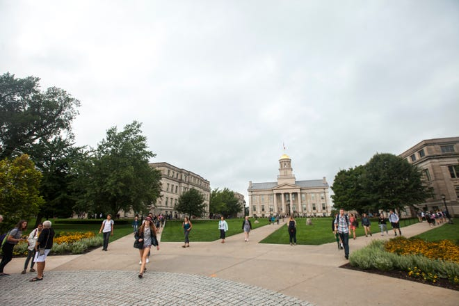 Students walk to class during the first day of the University of Iowa fall semester on Monday, Aug. 20, 2018, on the Pentacrest past the Old Capitol building in Iowa City.
