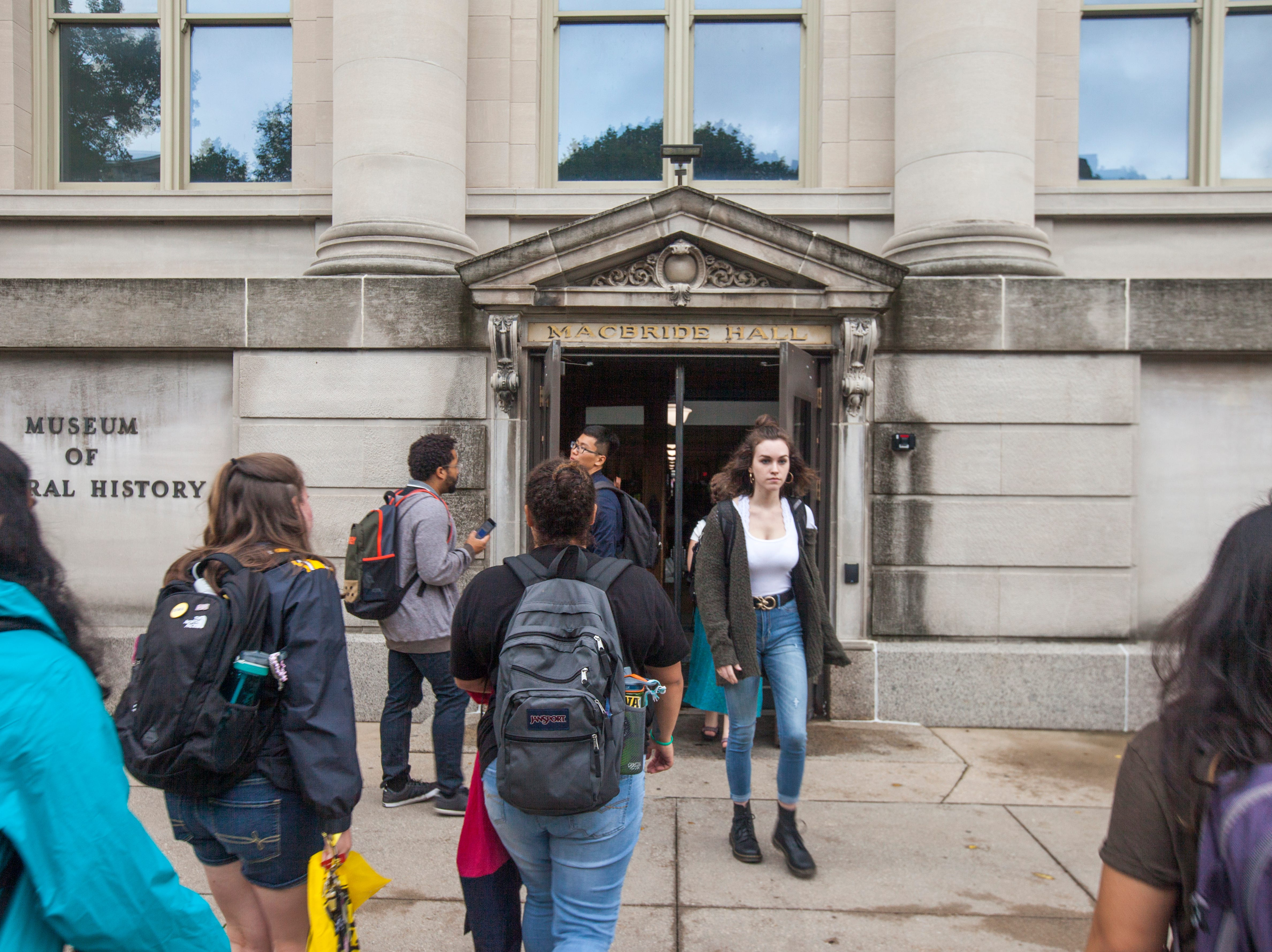 Students walk to class during the first day of the University of Iowa fall semester on Monday, Aug. 20, 2018, at Macbride Hall in Iowa City.