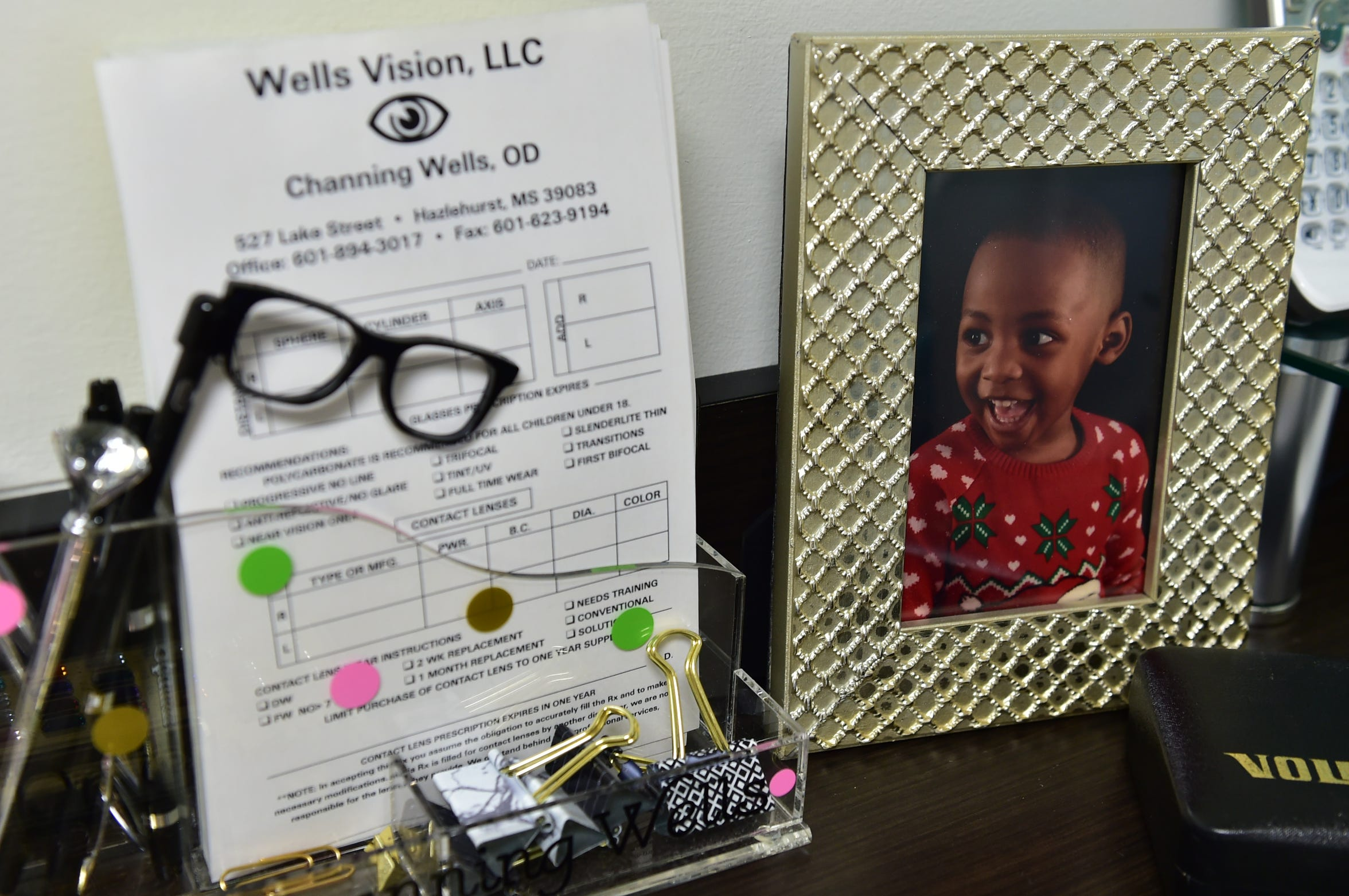 Dr. Channing Wells' exam room desk is adorned with a photo of her young son, Josie Wells Jr.