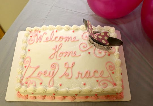 Cakes for the welcome home celebration for Zoey Grace Alford after her surgery and three-week stay in Boston, Ma. for her surgery to correct the birth defect and disfigurement of her skull.  The party was held in Pheba, Miss. Sunday afternoon Aug. 19, 2018. (Jim Lytle/Special to the Clarion Ledger)