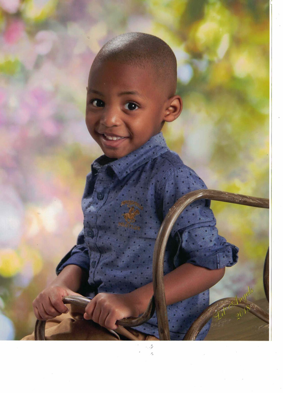 "Josie Wells Jr. is shown in a recent school portrait. His mother, Dr. Channing Wells, was four months pregnant with ""Jojo"" when his father, Deputy U.S. Marshal Josie Wells Sr., was shot and killed by a suspect during a raid."
