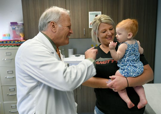 Dr. Craig Towers, 2018 Health Care Heroes recipient, follows up with patient Jena Jones and her 7-month-old daughter, Raelyn, on Aug. 17, 2018.