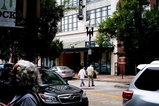 Pedestrians cross Gay Street in front of Sterchi Lofts in Old City in downtown Knoxville, Tennessee on Saturday, August 18, 2018.