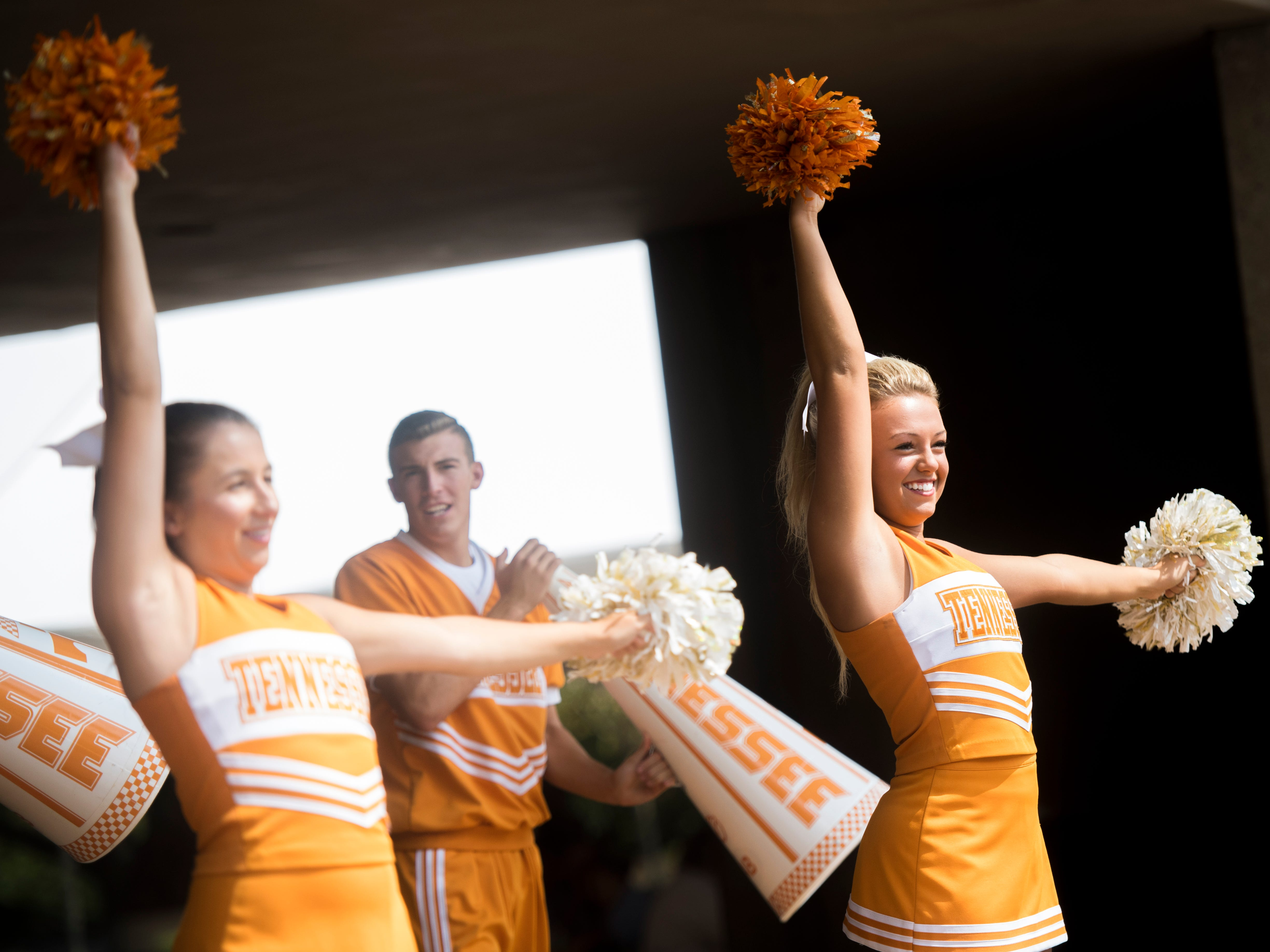 University of Tennessee cheerleaders perform cheers as faculty and staff enjoy a start-of-the-semester picnic held at McClung Plaza on UT's campus on Monday, August 20, 2018.