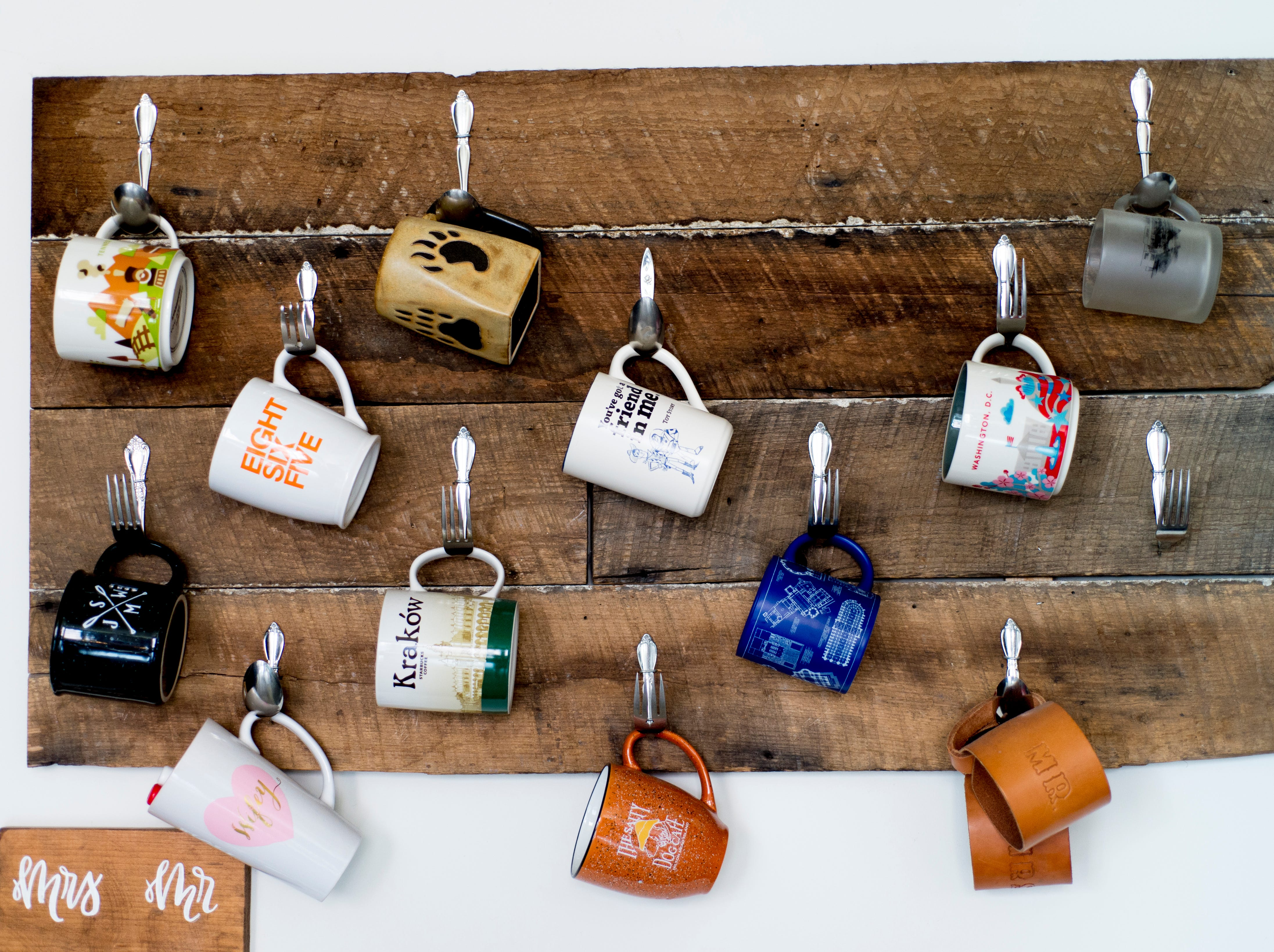 Mugs hang on the wall at the JFG loft of Logan and Katherine Higgins in Old City in downtown Knoxville, Tennessee on Saturday, August 18, 2018.