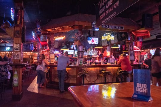 The interior of country music club Cotton Eyed Joe has a bar, pool tables, a stage, dance floor and other features.