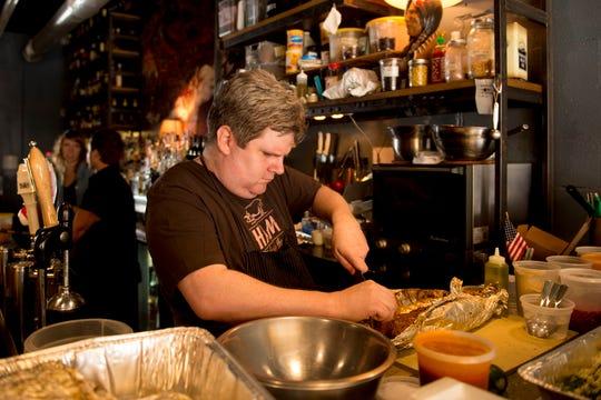 Chef Joe Cunningham prepares food at the Public House.