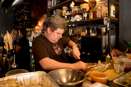 Chef Joe Cunningham prepares food at the Public House.