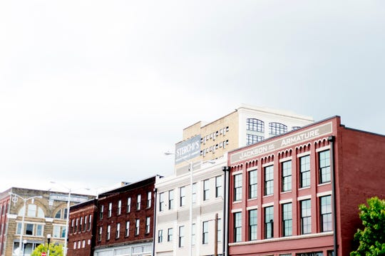 Sterchi Lofts rises over Jackson Ave in Old City in downtown Knoxville, Tennessee on Saturday, August 18, 2018.