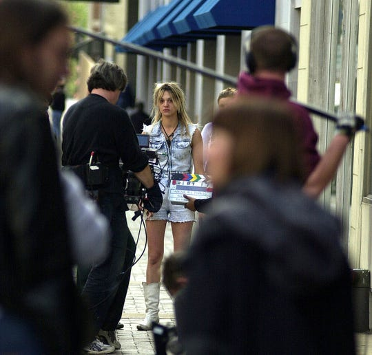 """Asia Argento, center, stars in and directs the movie """"The Heart Is Deceitful Above All Things"""" on Gay Street in downtown Knoxville on Friday, Oct. 3, 2003."""