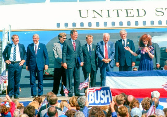 Entertainer Naomi Judd introduces President George H. W. Bush during a campaign appearance on Sept. 29, 1992, at McGhee Tyson Airport. Sharing the stage, from left, are Secretary of Education Lamar Alexander, U.S. Rep. Don Sundquist, entertainer Ricky Skaggs, Mayor Victor Ashe, U.S. Rep. James Quillen, and U.S. Rep. John J. Duncan Jr. Former senator Howard Baker stands behind Judd.