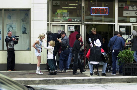 """Asia Argento, second from left, gives direction during the filming of the movie """"The Heart is Deceitful Above All Things"""" on Gay Street in downtown Knoxville on Friday, Oct. 3, 2003. In front of her is one of the twin actors, Dylan or Cole Sprouse, who play her son in the film."""