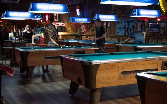 The interior of country music club Cotton Eyed Joe has pool tables, a stage, dance floor and other features.
