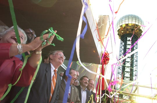 Knoxville City councilwoman Barbara Pelot, left, Mayor Victor Ashe and many other dignitaries watch the streamers fall after the ribbon cutting ceremony for the Knoxville Convention Center in 2001.