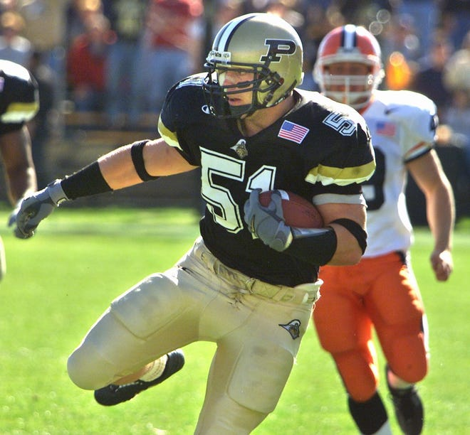 Purdue linebacker Joe Odom runs back a fake punt over 50 yards to set up Purdue's first score in a 2001 game against Illinois.