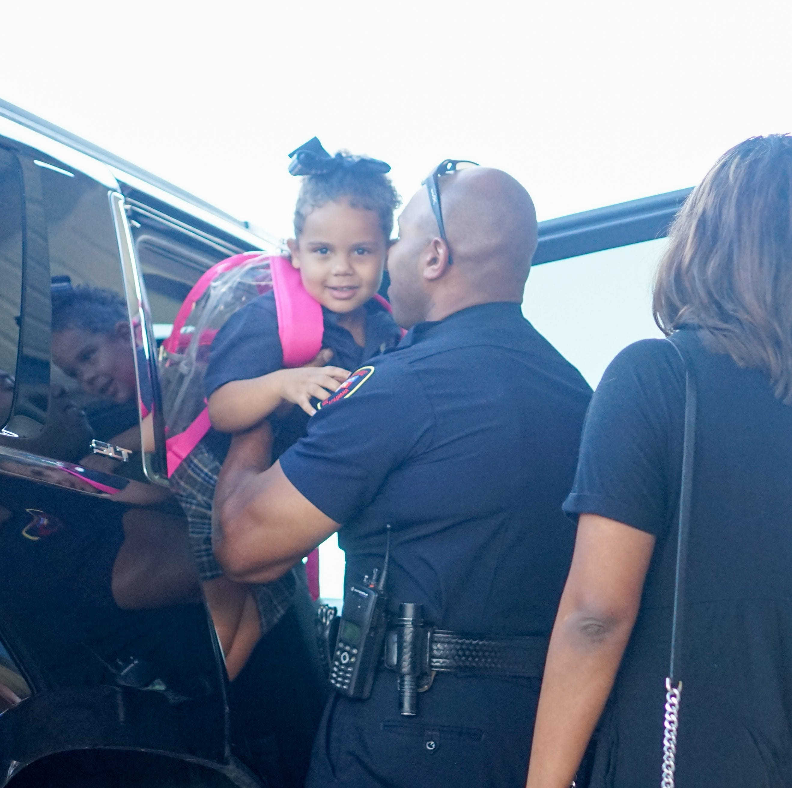 Officers escort Cpl. Middlebrook's daughter to first day of school