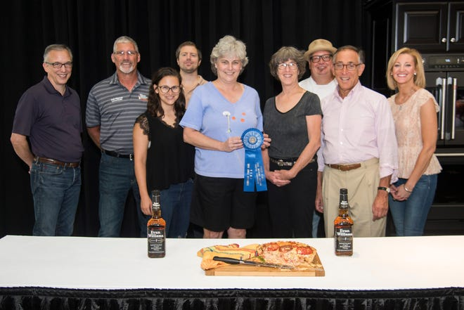Christy Cox of Louisville (center) took home the blue ribbon in the 2018 Evan Williams Bourbon Cooking Contest with her country ham and tomato pie.