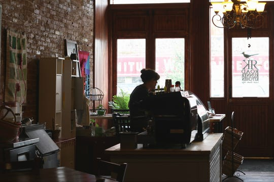 Co-owner Sarah Hastings sits behind the register at Roadrunner Kitchen, 145 E. Main St. New Albany, Indiana.