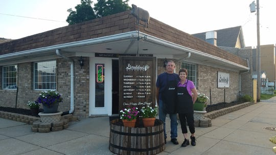 Owners Bob and Christa Hoyland stand outside Geraldine's Kitchen in Jeffersonville, Indiana.