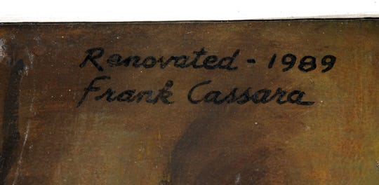 A detail of  Frank Cassara's  credit on one  of the murals in the Board of Water & Light's Dye Water Conditioning Plant in Lansing, May 26, 2008.
