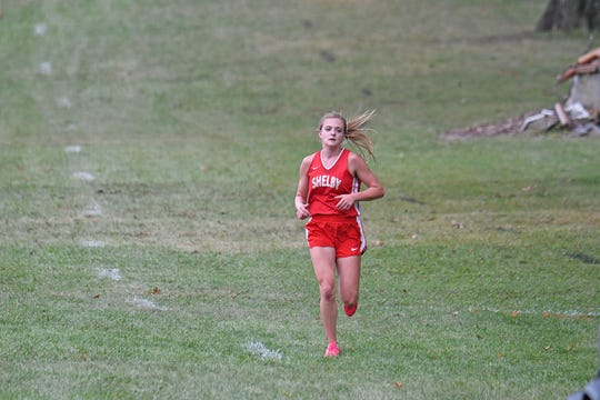 Makenna Heimlich of Shelby won the 2018 Girls Richland County Cross Country Invitational at Madison High School on Monday.