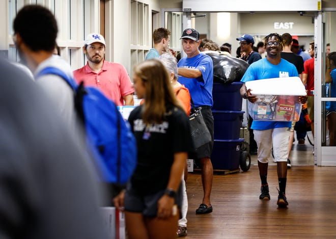 University of Memphis students and their parents wait for the elevator as they move into Centennial Place residence hall for the fall semester. UofM kicked off a two-day event, where hundreds of volunteers helped get students into their new dorm rooms.