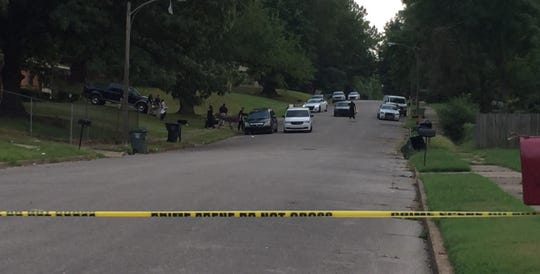 Police were rolling away a body from a crime scene after they had blocked off three blocks of Madwell Street following a homicide Sunday.