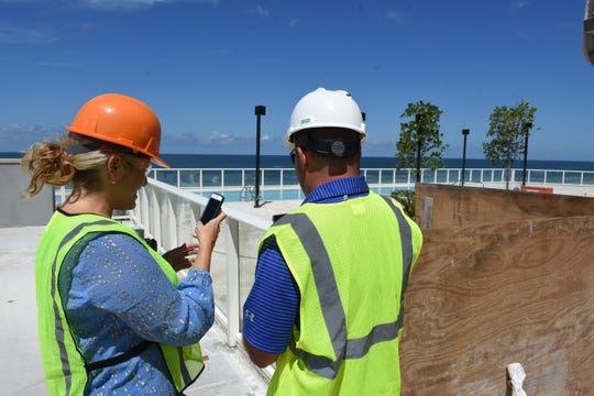 Marketing director Amanda Cox and director of guest experiences Nick Wagner lay out the scenario for the new fifth-floor pool. Marco Island's JW Marriott hotel has a variety of projects underway, with the entire renovated property due to be open for the coming winter season.