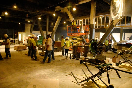 """Workers swarm in what will be the """"10K Alley"""" gaming area in their new tower. Marco Island's JW Marriott hotel has a variety of projects underway, with the entire renovated property due to be open for the coming winter season."""