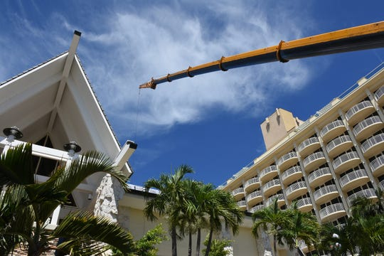 A crane helps to reroof a portion of the hotel roof. Marco Island's JW Marriott hotel has a variety of projects underway, with the entire renovated property due to be open for the coming winter season.