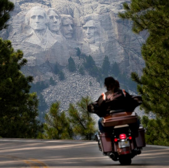 A Harley-Davidson motorcycle exits the Scovel Johnson Tunnel on Iron Mountain near Mount Rushmore Aug. 9 during the 78th Sturgis Motorcycle Rally in Keystone, South Dakota.