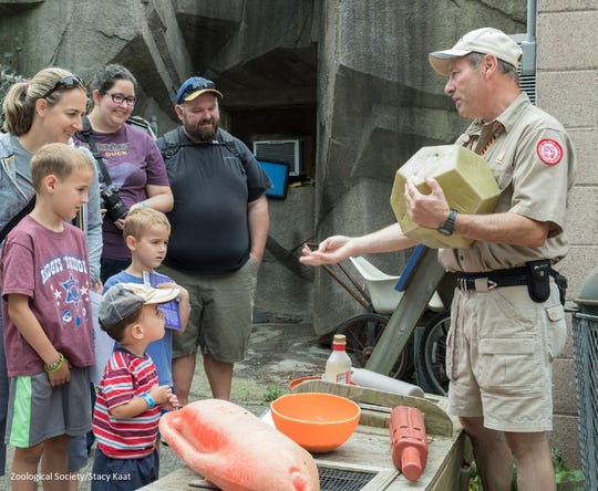Experienced tour guides show animal sponsors behind-the-scenes things at the Milwaukee County Zoo.