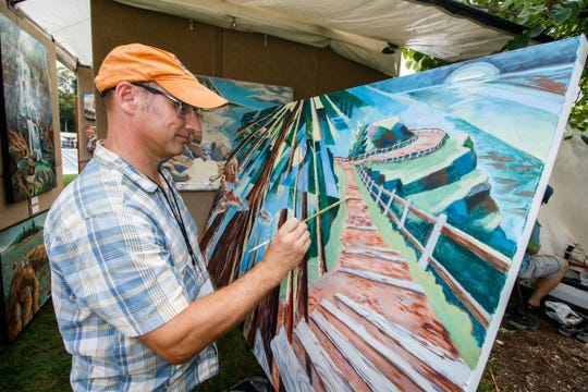 Jeffrey Dallas of Grafton works on a landscape painting during the 2018 Oconomowoc Festival of the Arts. This year's festival is Aug. 17-18 in Fowler Park.