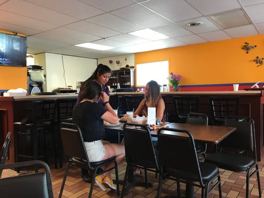 Vanessa Ramirez, Nory Flores' daughter, serves lunch on Casa Noble's first day in business on Aug. 16. A number of Nory's family members have helped launch the new business.