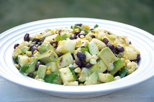Avocado and black beans mingle deliciously with grilled corn and zucchini in this summery salad.
