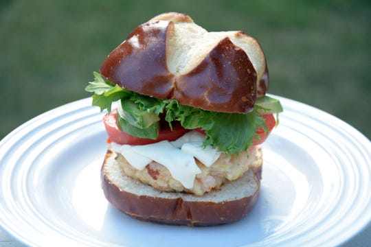 Shrimp burgers, fried like crab cakes, are served on pretzel buns.
