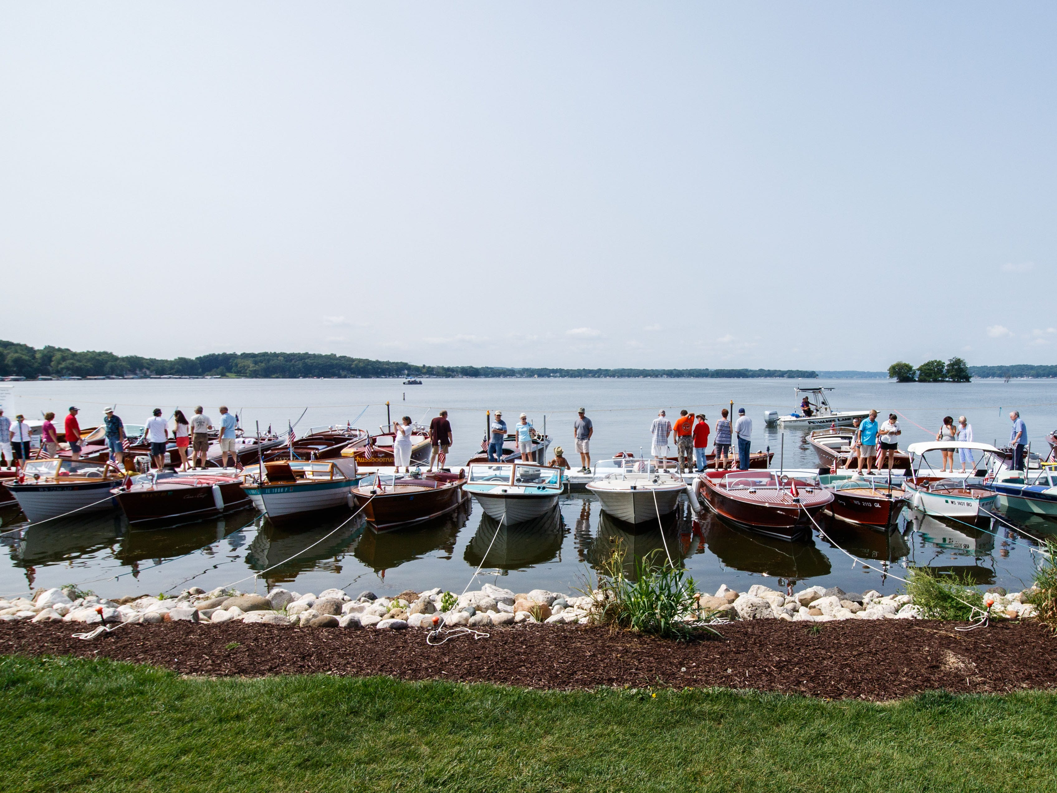 Boating enthusiasts enjoy a day on Pewaukee's lakefront during the 14th annual Pewaukee Antique & Classic Boat Show & Vintage Car Show on Saturday, August 18, 2018. The event, hosted by the Glacier Lakes Chapter of the Antique and Classic Boat Society, features antique and classic boats, classic cars, vintage big wheel bicycles, live music, children's activities and more.