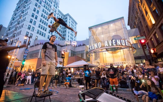 Jeremy Witter of Milwaukee attends a  Night Market event in 2018. He volunteered to stand as Allen Grant, 11, jumps over him. Grant is a part of a group called Milwaukee Flyers that started in 2005.