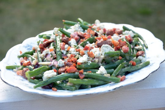Blue cheese and pancetta add hearty flavors to this pretty salad.