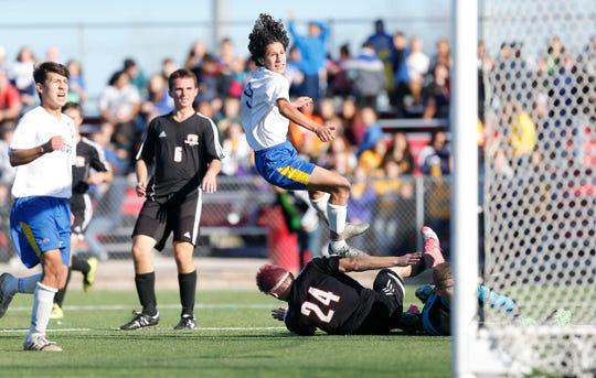 Delavan-Darien senior Zeus Huerta (in air) returns after scoring 51 goals for the Comets last season.