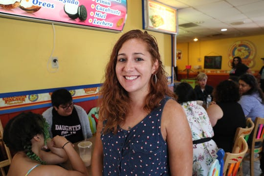 Katie Loughmiller attends the meeting of Latina artists at Chicken Palace.