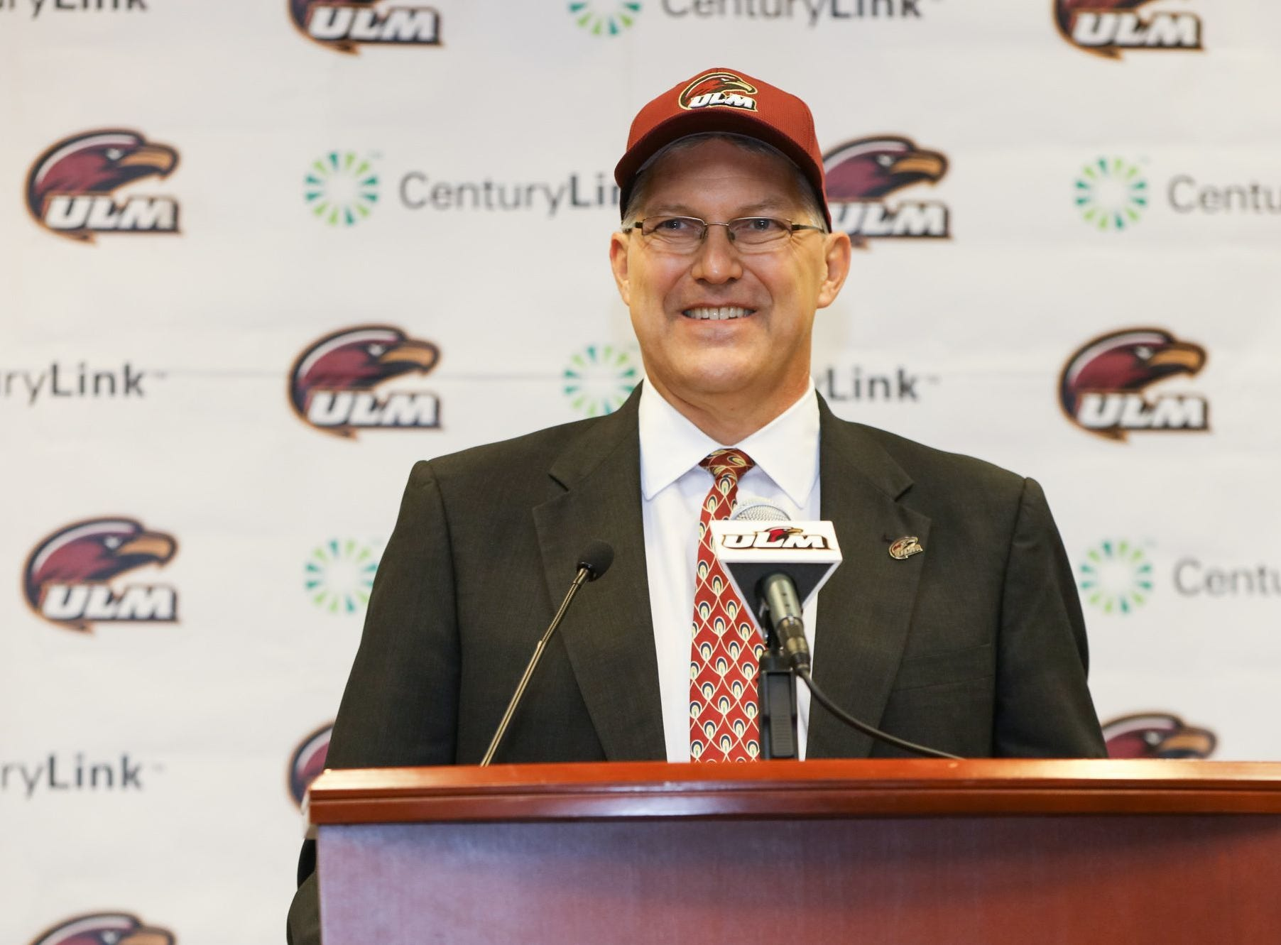 Nick Floyd stands at the podium after being introduced as ULM athletic director in July 2017.