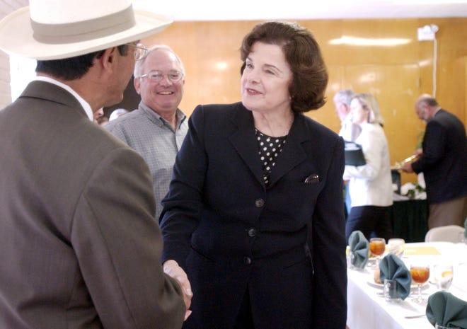 Visalia Mayor Jesus Gamboa greets Senator Dianne Feinstein at a luncheon at the Exeter Veterans Memorial Building on Monday, April 2, 2007. Photo taken on 4/2/07 in Exeter.  Photo by Teresa Douglass 0402_Diane_Feinstein_0135  Camera data: 4/2/07 at 12:01:01, ISO 1250, 1/100 @ f/3.2, WB=FLUORESCENT, 30mm, MODE2, FINE, frame 0135.