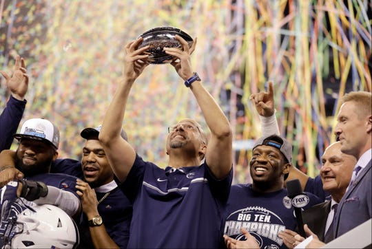 Penn State head coach James Franklin holds the trophy after Penn State won the Big Ten championship NCAA college football game Saturday, Dec. 3, 2016, in Indianapolis. Penn State won 38-31. (AP Photo/Michael Conroy)