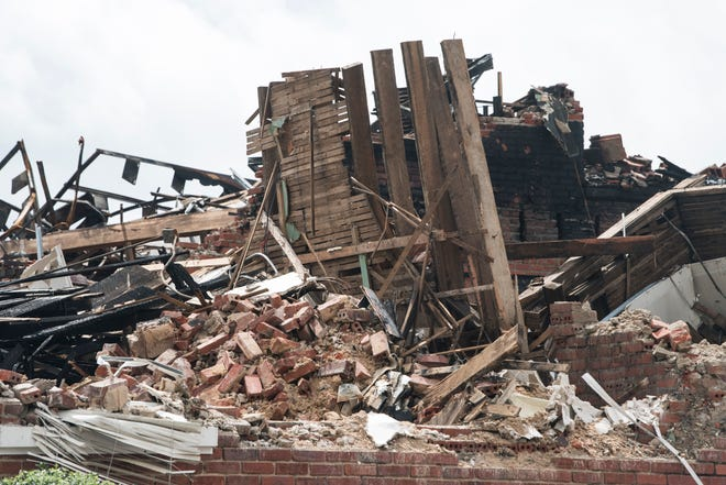 Rubble from a Saturday morning fire at Booker T. Washington Magnet High School in Montgomery, Ala., on Monday, Aug. 20, 2018.