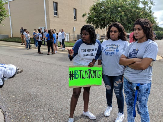 From left to right:  Booker T. Washington Magnet High School students Lydia Williams and Lindsey Towns stand with BTW alum Paige Towns at Hutchinson Missionary Baptist Church two days after BTW's Building C burned down.